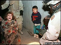 Children react after US soldiers fired on a car they were in, killing their parents