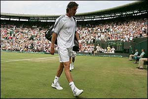Safin walks from Court One