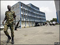 Ivorian security forces guard a television headquarters in Abidjan