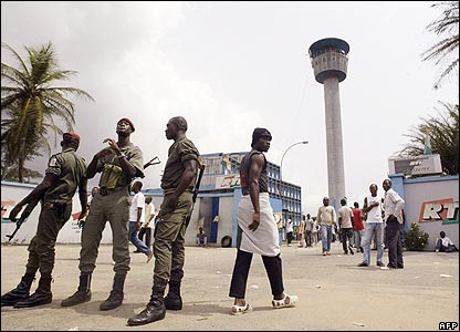 Police outside state television headquarters in Abidjan, Ivory Coast