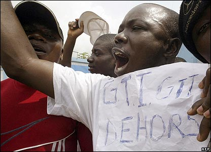 Protesters outside state television headquarters in Abidjan, Ivory Coast