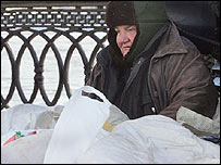 A homeless woman surrounds herself in plastic bags to keep warm(Photo: Mladen Antonov/AFP/Getty Images)