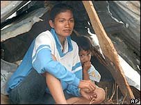 A mother and daughter shelter in Aceh, Indonesia, in January