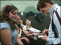 Andy Murray signs autographs at Wimbledon