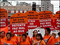 "Demonstrators hold banners reading ""The Aids movement alerts: Patents are bad for health"", December 2004"