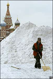 A man clears snow near St. Basil's Cathedral in Moscow's Red Square