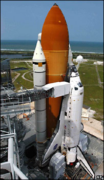 Discovery on its launch pad (AP)