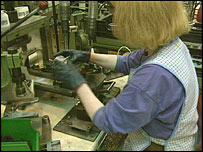 Woman at factory machine