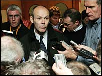 Clive Woodward is surrounded by journalists looking for answers