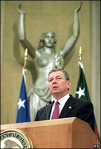 John Ashcroft speaking in front of the Spirit of Justice