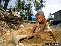 A child digs foundations for a new home in Galle, Sri Lanka
