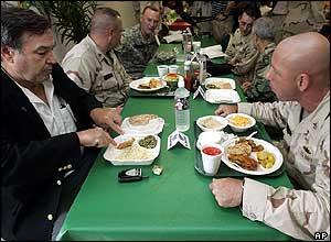 Republican Congressman Duncan Hunter eating with servicemen
