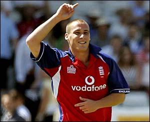 Simon Jones celebrates taking the wicket of Shahriar Nafees