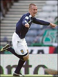 Miller celebrates scoring against Italy