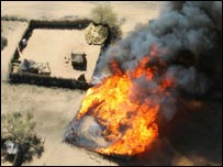 Burning homestead in a Darfur village