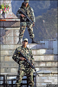 Soldiers guard the royal palace in Kathmandu during a day-long curfew
