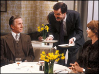 Basil Fawlty in his hotel's restaurant