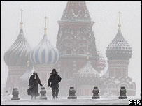 Russians walk through snow in Red Square