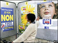 A young boy looks at posters promoting the 'yes' and 'no' campaigns in France's 29 May referendum