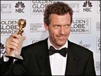 Hugh Laurie accepts his Golden Globe for House