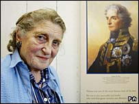 Anne Tribe, oldest living relative of Lord Nelson, with a portrait of her ancestor