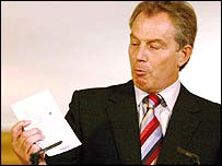 Tony Blair looking at a sample biometric passport
