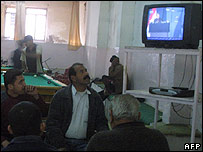 Iraqis watch the election results on TV at a coffee shop in Baquba, Baghdad