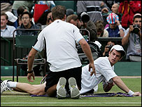 Andy Murray receives treatment during his match against David Nalbandian