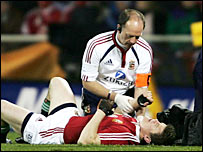 Brian O'Driscoll receives treatment for his injured shoulder