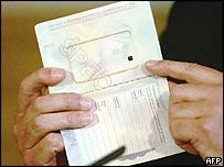 Tony Blair holds up a sample biometric passport
