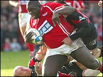 Scarlets prop Martyn Madden dives over for a try against Toulouse