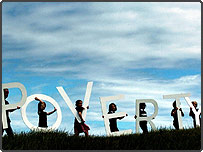 Actor Billy Boyd joins school children carrying giant letters spelling the word POVERTY on Calton Hill, Edinburgh ahead of the G8 summit (PA)