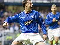 Kris Boyd celebrates his early goal at Ibrox
