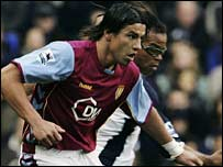 Aston Villa's Milan Baros and Edgar Davids of Spurs