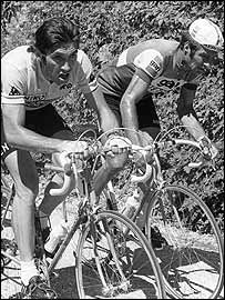 Belgian Eddy Merckx (L) rides uphill with Frenchman Raymond Poulidor during the 10th stage of the Tour de France between Aspro-Gaillard and Aix-les-Bains  in July 1974
