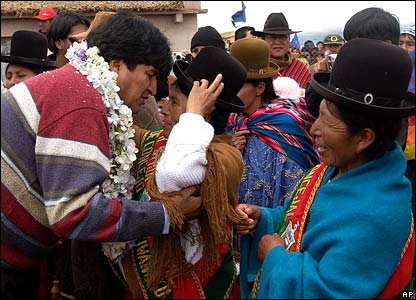 Evo Morales greets indigenous supporters before the ceremony