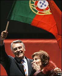 Anibal Cavaco Silva waves a Portuguese flag