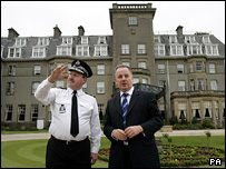 Jack McConnell with police officer at Gleneagles