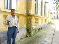 Feraru next to the building where he lives. The institution is in the background