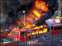A bus engulfed in flames