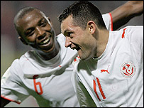 Francileudo Dos Santos (right) celebrates his leveller for Tunisia