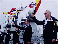 The crew of HMS Illustrious greet the Queen with hip hip hoorays