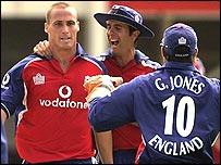 Simon Jones (left) takes a wicket