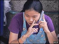Thai woman talks on a mobile phone