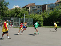 Children in state care playing football in Baia Mare