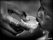 Sudanese child drinking clean water at Darfur refugee camp