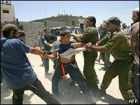 Jewish settler being arrested