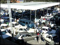Zimbabwean drivers queue at a petrol station which has just received a fuel shipment