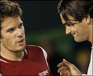 Tommy Haas congratulates Roger Federer