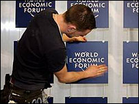 Worker fixes World Economic Forum logo